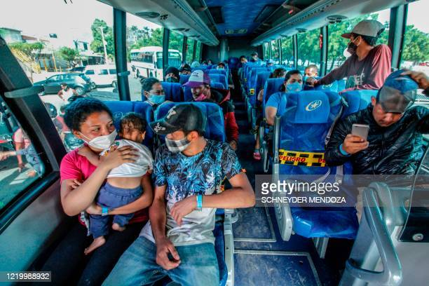 Venezuelans sit on a bus as they are being transferred from the Simon Bolivar international crossing point to the Tienditas International Bridge...