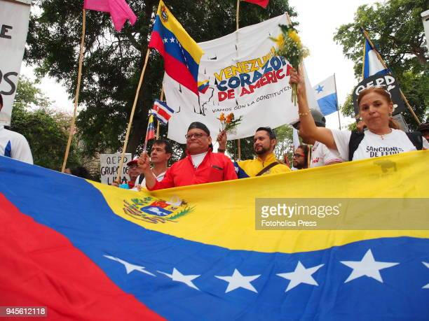 Venezuelans took to the streets with a flag when thousands of Latin American left wing activists conducted an antiimperialist march against the...