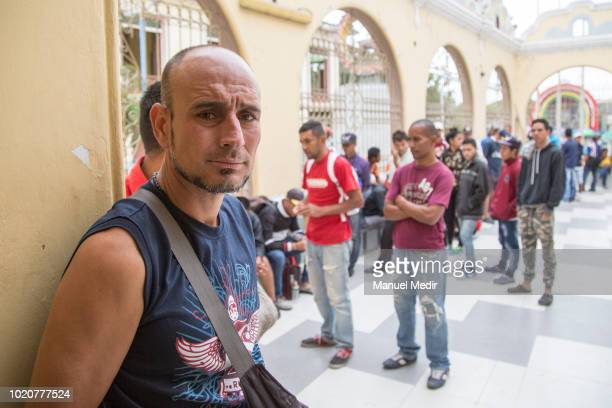 Venezuelans wait to receive food at the church of San Nicolás on August 17 2018 in Tumbes Peru According to Peruvian Superintendence of Migrations...