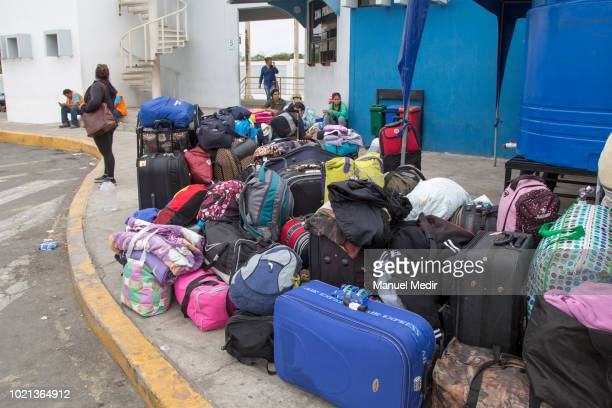 Venezuelans wait to verify their documents to cross into Peru on August 18 2018 in Huaquillas Ecuador According to Peruvian Superintendence of...