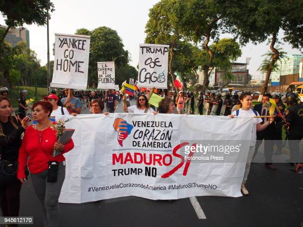 Venezuelans with a banner 'Maduro Yes Trump No' when thousands of Latin American left wing activists conducted an antiimperialist march against the...