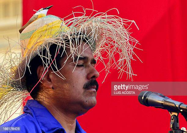 Venezuela's acting President Nicolas Maduro gestures during a campaign rally in Catia la mar state of Vargas on April 9 2013 Venezuelans will elect...