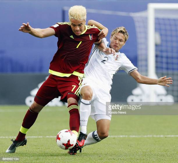 Venezuela's Adalberto Penaranda and So Fujitani of Japan vie for the ball in the first half of an Under20 World Cup round of 16 match in Daejeon...