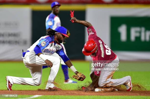 Venezuela's Adonis Garcia arrives safely at second base ahead of a tag by Dominican Republic's second baseman Allen Hanson during a Caribbean Series...