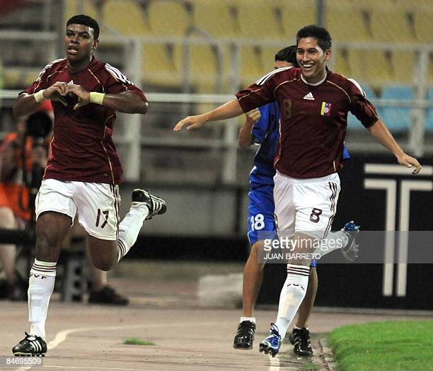 Venezuela's Adrian Lezama and Mauricio Parra celebrates after scoring against Uruguay during their U-20 South American Championship football match at...