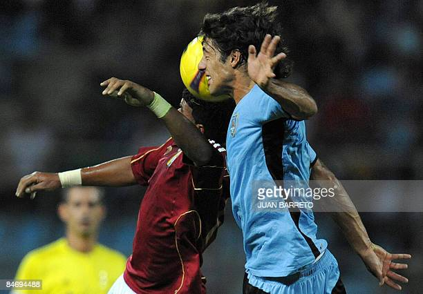 "Venezuela's Adrian Lezama vies for the ball with Uruguay's Fabian Herrera during their U-20 South American Championship football match at the ""Jose..."