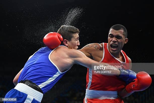 Venezuela's Albert Ramon Ramirez fights Algeria's Abdelhafid Benchabla during the Men's Light Heavy match at the Rio 2016 Olympic Games at the...