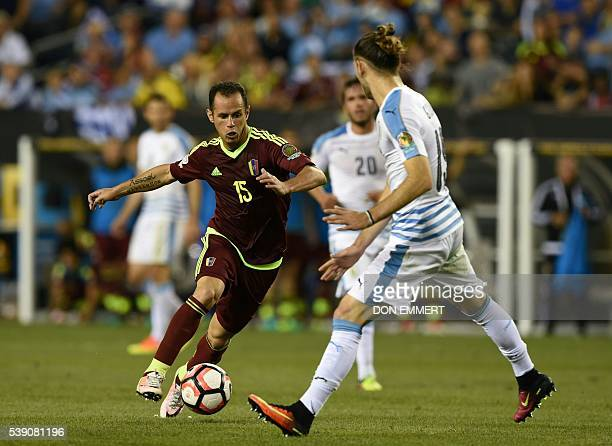 Venezuela's Alejandro Guerra is marked by Uruguay's Gaston Silva during the Copa America Centenario football tournament in Philadelphia Pennsylvania...