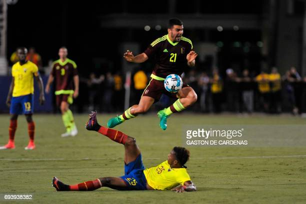 Venezuela's Alexander Gonzalez challenges for the ball against Dario Aimar during their friendly soccer match at FAU stadium in Boca Raton Florida...