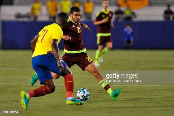 Venezuela's Alexander Gonzalez vies for the ball against Gabriel Achiller of Ecuador during their friendly soccer match at FAU stadium in Boca Raton...