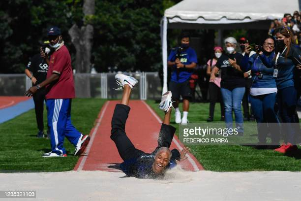 Venezuela's athlete Yulimar Rojas, gold medallist in the Tokyo 2020 Olympic Games, falls in an attempt of jumping during an exhibition with children...