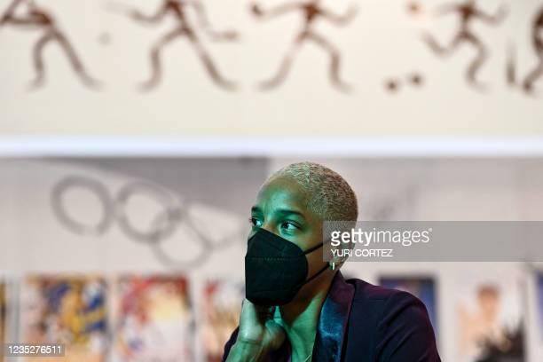 Venezuela's athlete Yulimar Rojas, gold medallist in Tokyo 2020 Olympic Games, gestures as he speaks during an inteview in Caracas on September 15,...