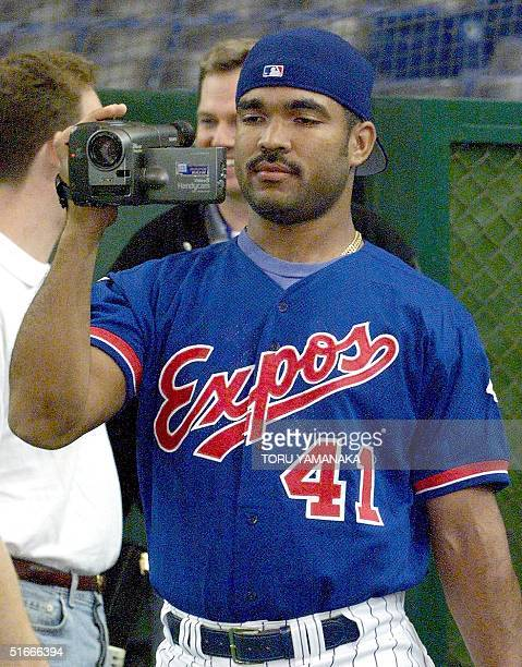Venezuela's baseball player Ugueth Urbina of Montreal Expos uses his camcorder during the official training of the USJapan All Star Series in Tokyo...