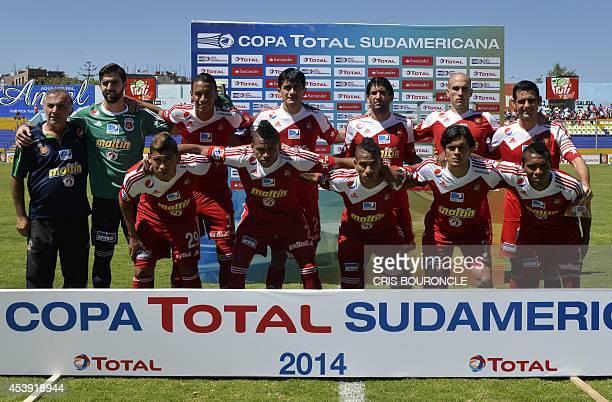 Venezuela's Caracas' players pose before the beginning of their Copa Sudamericana football match against Peru's Inti Gas at the Ciudad de Cumana...