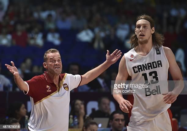 Venezuela's coach Nestor Garcia celebrates a point next to Canada's power forward Kelly Olynyk during their 2015 FIBA Americas Championship Men's...