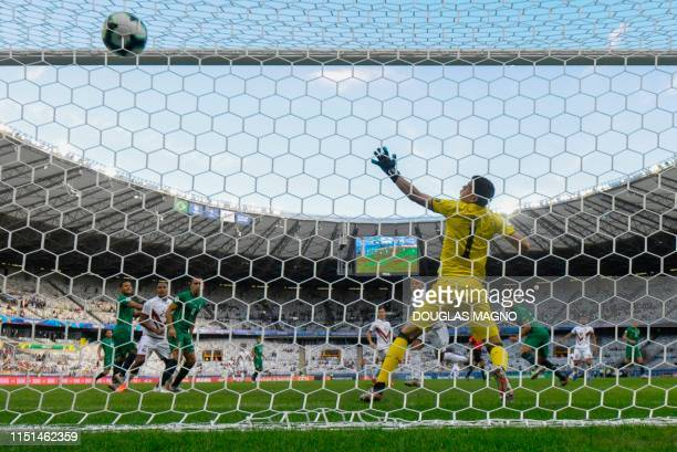 Venezuela's Darwin Machis scores a header past Bolivia's goalkeeper Carlos Lampe during their Copa America football tournament group match at the...