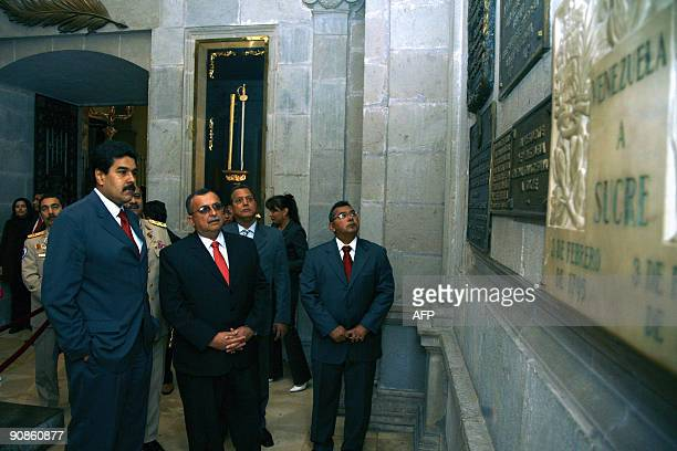 Venezuela's Defence Minister Ramon Carrizalez and Foreign Affairs Minister Nicolas Maduro visit the tlomb of Liberator Antonio Jose de Sucre at the...
