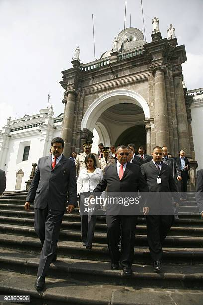 Venezuela's Defence Minister Ramon Carrizalez and Foreign Affairs Minister Nicolas Maduro leave the Metropolitan Cathedral in Quito after visiting...
