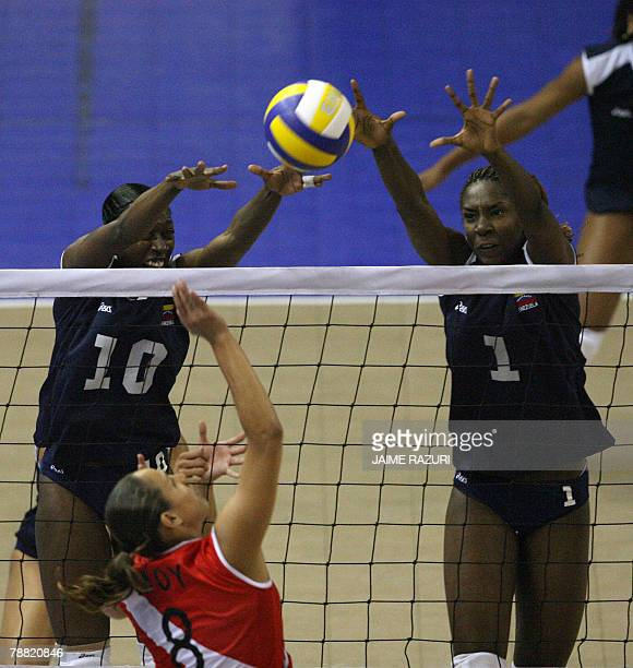 Venezuela's Desiree Glod and Yessica Paz block the hit of Peru's Milagros Moy during the South American Women's Olympic Qualifying Tournament in Lima...