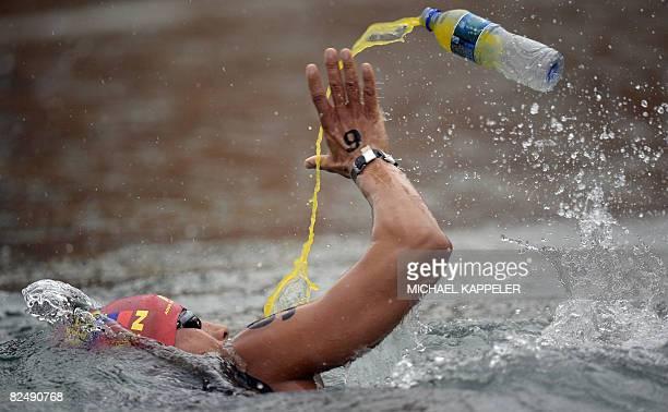 Venezuelas Erwin Leon Maldonado Savera receives a drink during the Mens 10km Marathon at the 2008 Beijing Olympic Games in Beijing on August 21 2008...