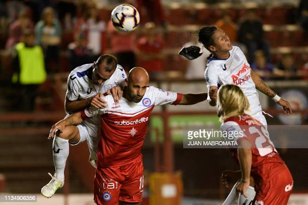 Venezuela's Estudiantes de Merida midfielder Edson Rivas heads the ball to make an own goal during the Copa Sudamericana football match against...