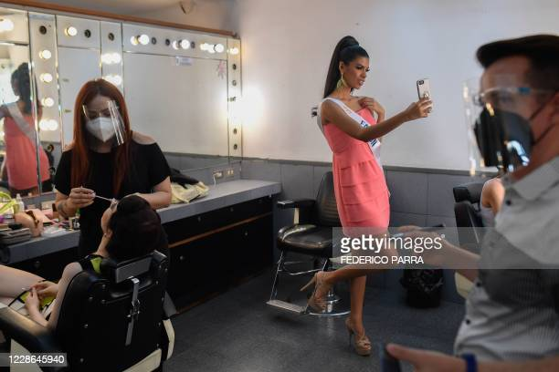 Venezuela's Falcon state contestant Betzabeth Hernandez takes a selfie in the dressing room before a meeting with judges of Miss Venezuela beauty...