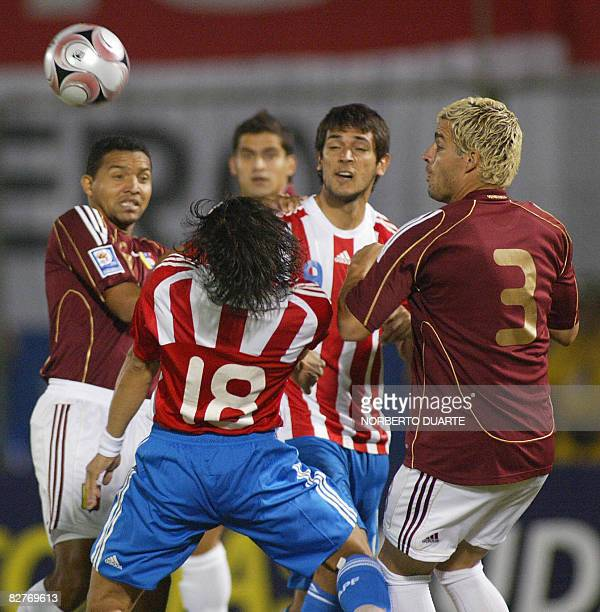 Venezuela's footballers Pedro Boada and Jose Manuel Rey vie for the ball with Paraguay's Roque Santa Cruz and Nelson Haedo during their FIFA world...
