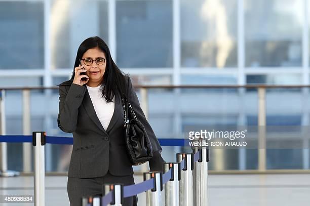 Venezuela's Foreign Minister Delcy Rodriguez talk on a mobile phone during the XLVIII Meeting of the MERCOSUR Common Market Council at Itamaraty...