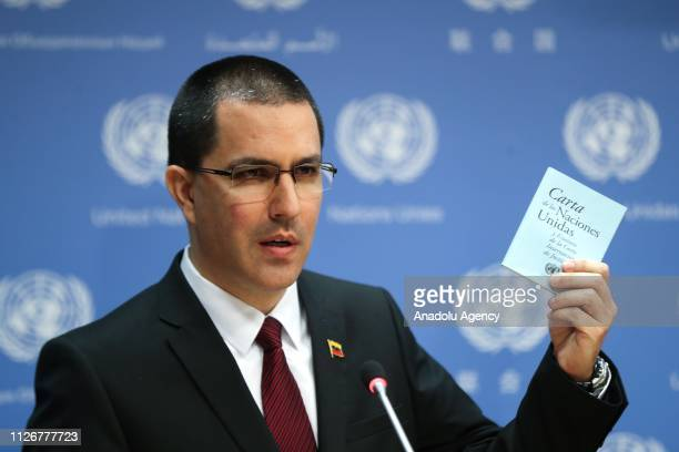 Venezuela's Foreign Minister Jorge Arreaza holds '' United Nations Charter'' during his press conference at the United Nations headquarters in New...