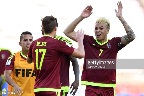 Venezuela's forward Adalberto Penaranda Maestre and defender Josua Mejias react after their U20 World Cup quarterfinal football match between...