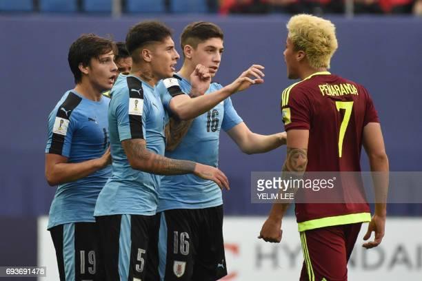 Venezuela's forward Adalberto Penaranda Maestre reacts next to Uruguay's forward Agustin Canobbio defender Mathias Olivera and midfielder Federico...