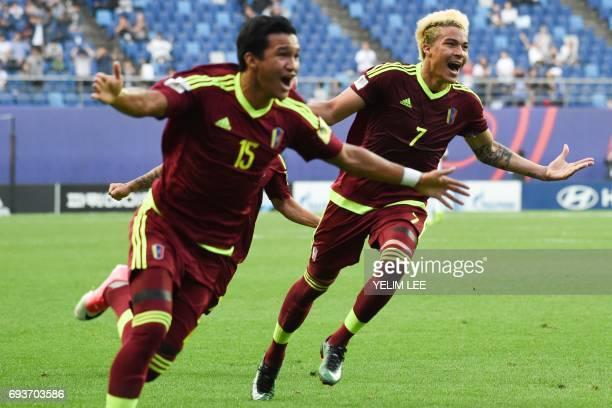 Venezuela's forward Samuel Sosa and forward Adalberto Penaranda Maestre celebrate a goal during the U20 World Cup semifinal football match between...