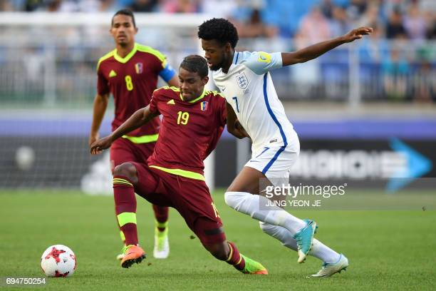 Venezuela's forward Sergio Cordova and England's midfielder Joshua Onomah compete for the ball during the U20 World Cup final football match between...
