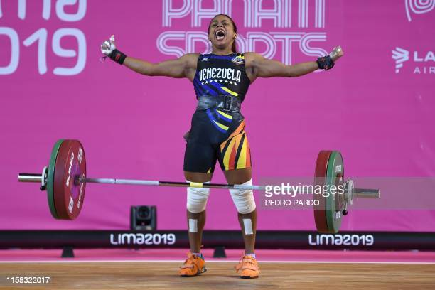 Venezuela´s Genesis Rodriguez reacts as she competes in the Women's 55 kg Group A category in the Weightlifting event of the Lima 2019 Pan-American...