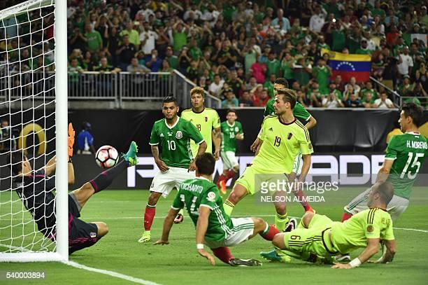 Venezuela's goalkeeper Daniel Hernandez blocks the ball twice during the Copa America Centenario football tournament match against Mexico in Houston,...