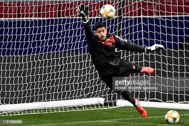 Venezuela's goalkeeper Rafael Romo dives for a ball during a training session at the Wanda Metropolitano stadium in Madrid on March 21 2019 on the...