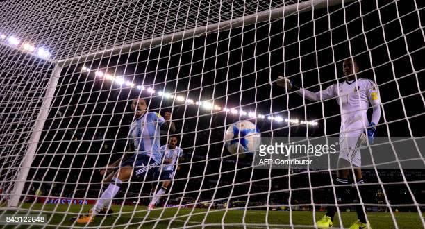 Venezuela's goalkeeper Wuilker Farinez reacts after teammate Rolf Feltscher scored an own goal during their 2018 World Cup qualifier football match...