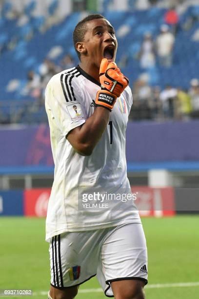 Venezuela's goalkeeper Wuilker Farinez reacts during the penalty shootout in the U20 World Cup semifinal football match between Uruguay and Venezuela...