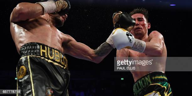 TOPSHOT Venezuela's Jorge Linares connects en route to a unanimous decision victory over England's Anthony Crolla in their WBA WBC Diamond Ring...