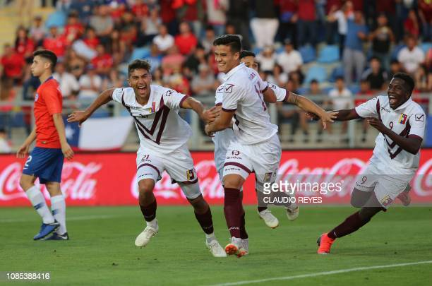 Venezuela's Jorge Yriarte celebrates with teammates after scoring against Chile during their South American U20 football match at El Teniente stadium...