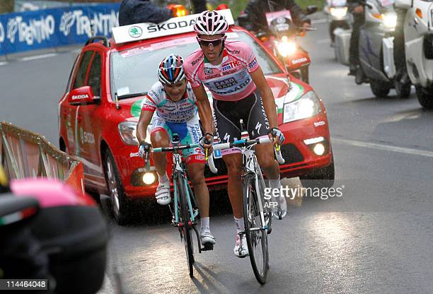 Venezuela's Jose Rujano of the Androni team and Spain's Alberto Contador of Saxo Bank compete during the 13rd stage of the 94th Tour of Italy run...