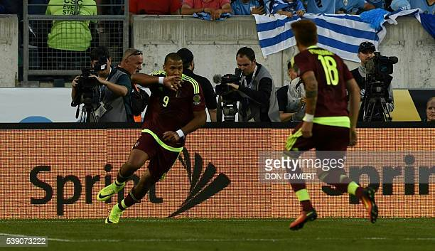 Venezuela's Jose Salomon Rondon celebrates with Adalberto Penaranda after scoring against Uruguay during the Copa America Centenario football match...