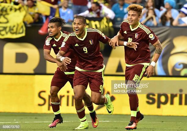 Venezuela's Jose Salomon Rondon celebrates with teammates after scoring against Uruguay during the Copa America Centenario football tournament in...