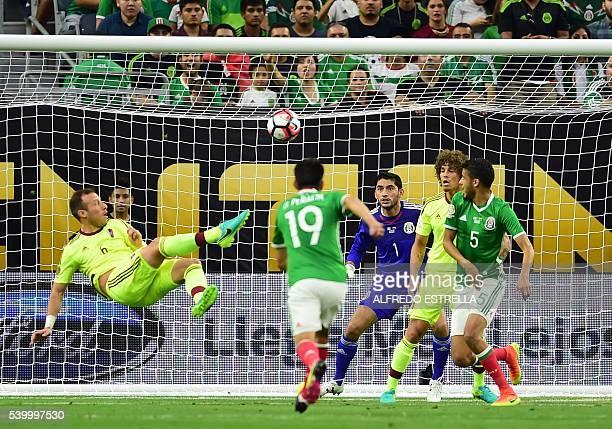 TOPSHOT Venezuela's Jose Velazquez scores against Mexico during their Copa America Centenario football tournament match in Houston Texas United...