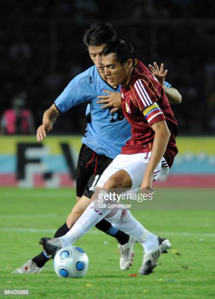 Venezuela's Juan Arango vies for the ball with Uruguay's Alvaro Fernandez during their 2010 FIFA World Cup South American qualifier at the Cachamay...