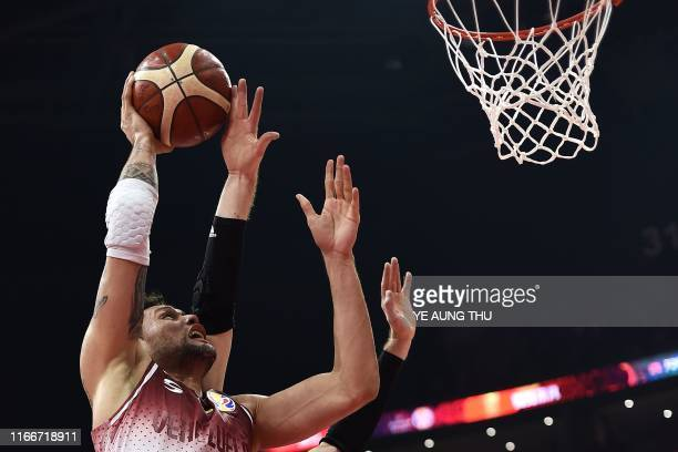 Venezuela's Michael Carrera goes to the basket during the Basketball World Cup Group I second round game between Venezuela and Russia in Foshan on...