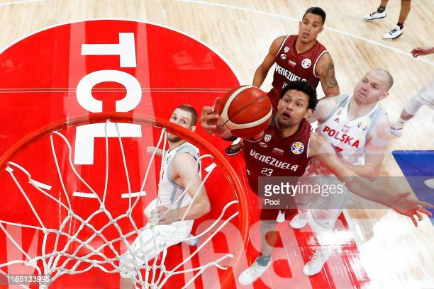 Venezuela's Michael Carrera in action with Poland's Damian Kulig during the FIBA World Cup 2019 Group A match between Poland and Venezuela at...