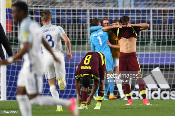 Venezuela's midfielder Yangel Herrera and Venezuela's forward Ronaldo Pena react after their defeat in the U20 World Cup final football match between...