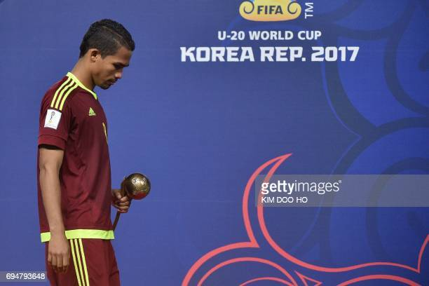 Venezuela's midfielder Yangel Herrera carries his trophy during the awards ceremony after defeat in the U20 World Cup final football match between...