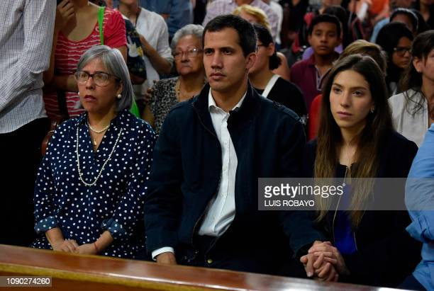Venezuela's National Assembly head and selfproclaimed acting president Juan Guaido accompanied by his wife Fabiana Rosales and his mother Norka...